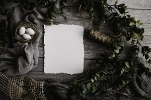 Wooden Table with greenery, bird nest and blank letter
